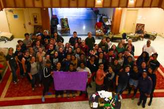 """Students occupy B.B. Dougherty administration building and hold a sign that reads, """"We, Appstate students, stand in solidarity with you!!!"""" Photo by Dallas Linger."""