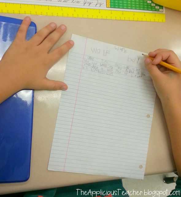 student writing folder