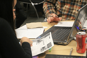 Brainstorming with notebooks and pens: Cindy Fong and Tony Orciuoli [photo: Sandra Lee]