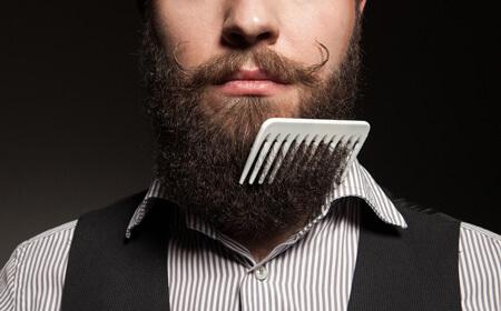 man combing beard