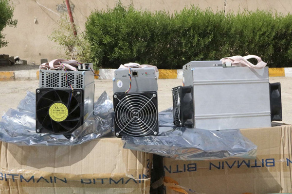 Boxes of machinery used in Bitcoin mining operations that were confiscated by police in Nazarabad, Iran. (AP)