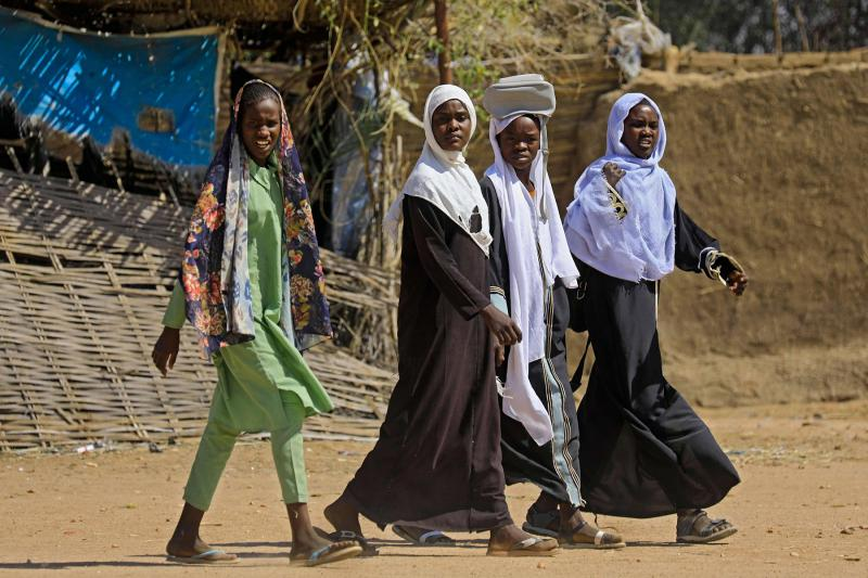 Displaced Sudanese women walk in the Otash internally displaced people's camp on the outskirts of Nyala town, the capital of South Darfur. (AFP)