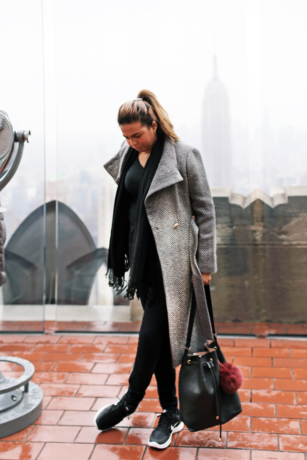 All black and a gray coat