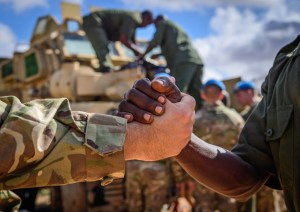 Two soldiers shaking hands