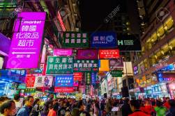 78215704-hong-kong-hong-kong-march-11-2017-busy-street-scene-at-night-in-kowloon-with-unidentified-people-hk-.jpg
