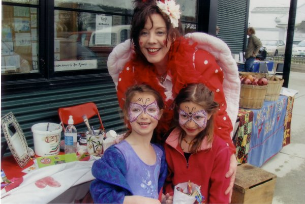 Painted children with The Art Angel Earth Day