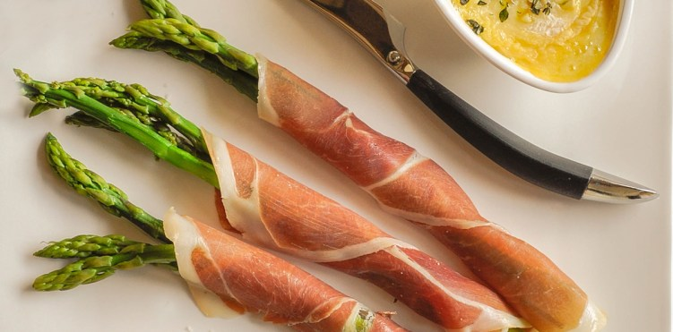 Asparagus wrapped in cured ham featured