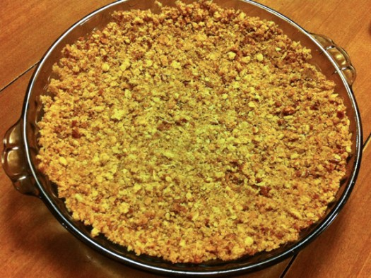"Add pecans, butter and brown sugar to cookie crumbles and press into 9"" pie dish"