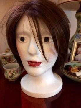 I enhanced the styrofoam head for my newly-pared down wig