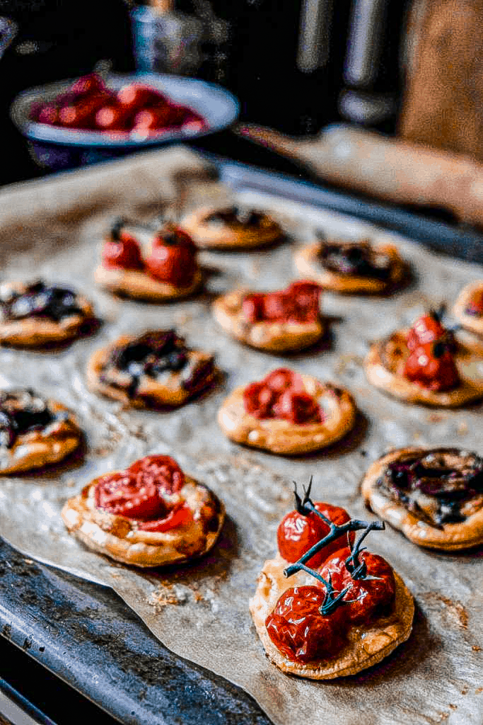 gruyere cheese puff pastry tarts with tomato, mushroom and thyme