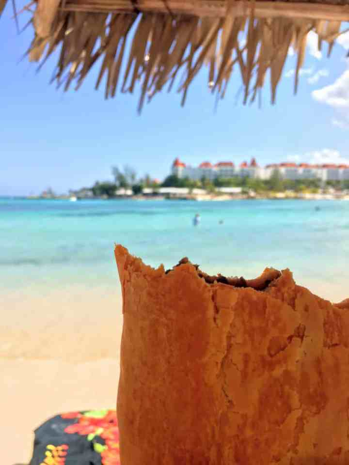 Eating beef patties on the beach in Jamaica.