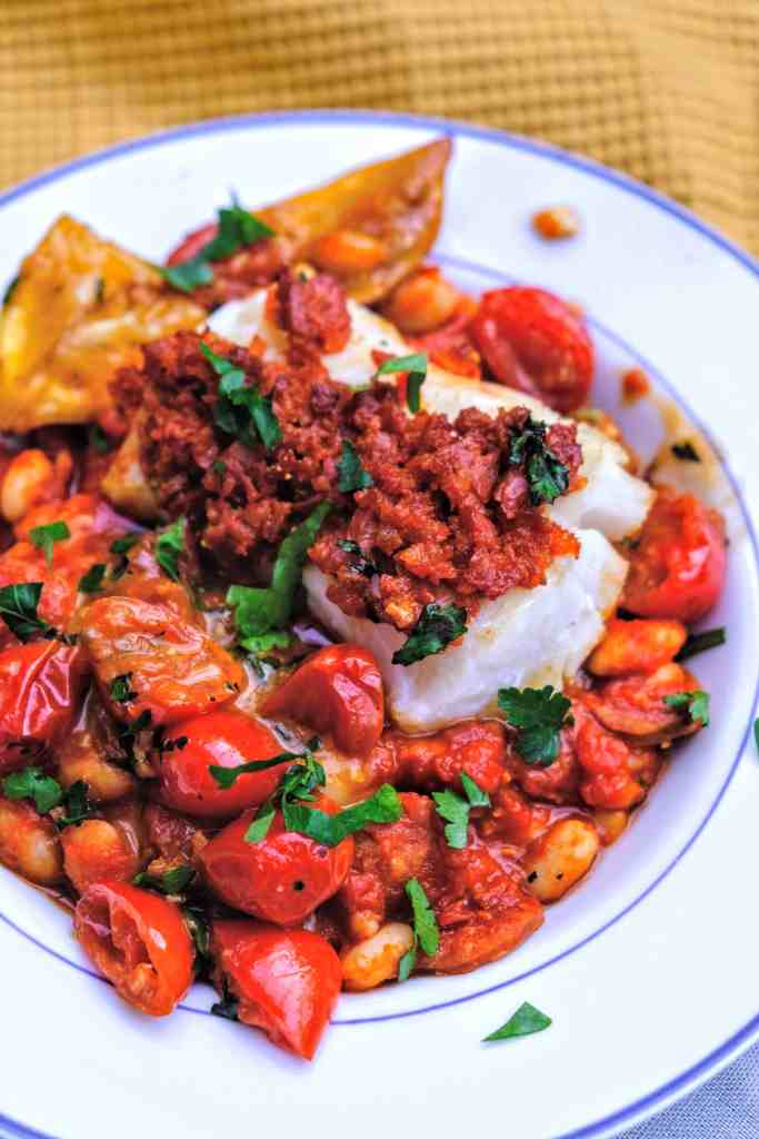 Portuguese inspired chorizo crusted cod with smokey tomato and white bean stew