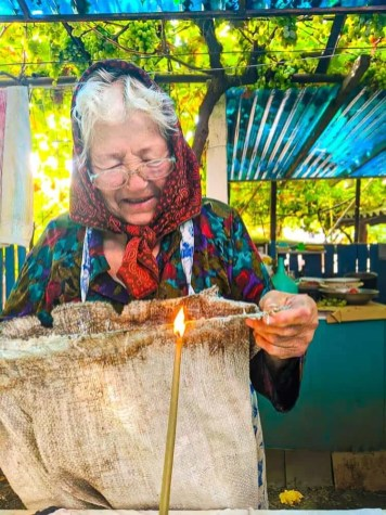 As a child my grandmother lived through a years long drought and famine that instilled in her a lifelong devotion to thrift. In the photo above, taken the day before the annual grape harvest, she's using a beeswax candle to seal off the frayed edges of a large sac that would be used for the second or third time to collect grapes from our small family vineyard. She's smiling as she tells us a joke or bit of some village gossip.