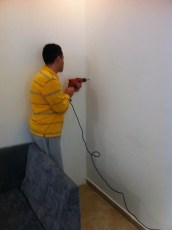 Our landlord drilling holes into the wall for us :-D