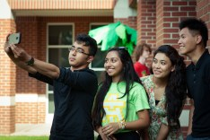 Selfie Groupie. Three young students were captured candidly taking selfie (photo by Iksan)