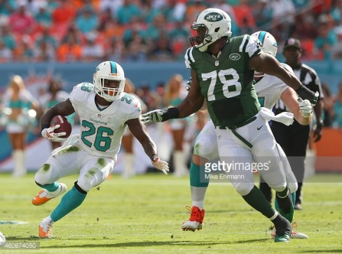 Lamar Miller making a play (Mike Ehrmann/Getty Images)
