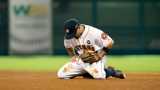 Carlos Correa dejected after a costly error to tie the game in the 8th inning of game 4.