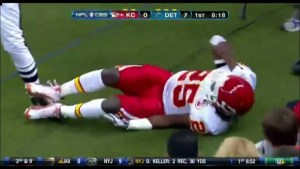Jamaal Charles, showing the affects of an acl tear, holding his knee in week 2 in Detroit during the 2011 season.
