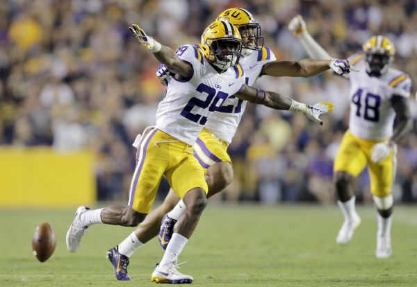 LSU cornerback Greedy Williams celebrates after intercepting a pass during a September 2017 game.