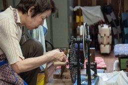 Artistan spooling thread on bobbin, Sasaki workshop