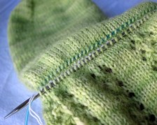 All stitches have been picked up. They are separated by a middle row of stitches.