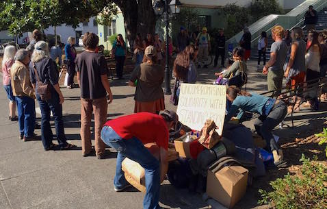 Growing pile of donated supplies at the Ukiah Courthouse rally (photo by Haji Warf).