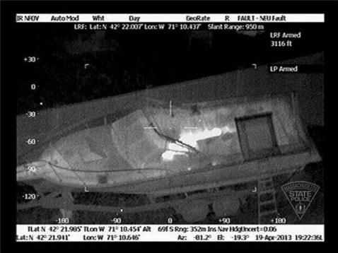 Thermal images of the Boston bomber hiding in a backyard boat taken