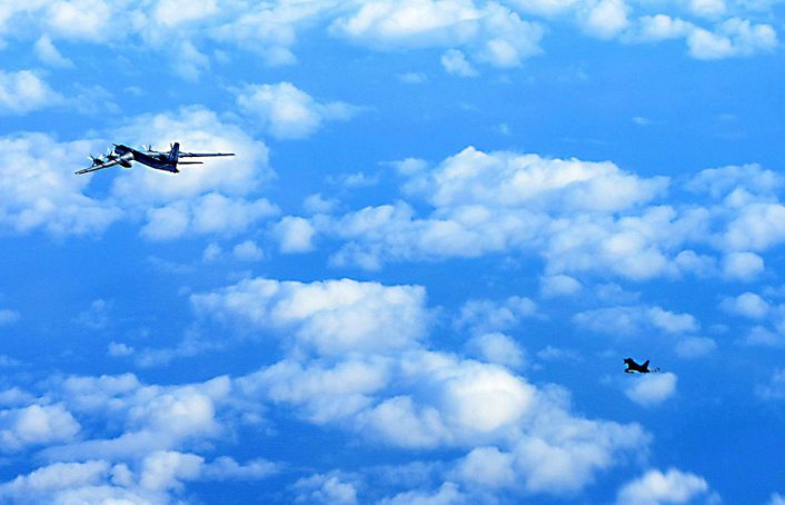 Tu-95 escorted by Typhoon