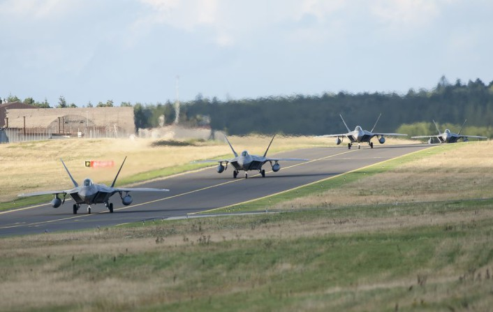 Four F-22 Raptor fighter aircraft taxi after landing at Spangdahlem Air Base, Germany, Aug. 28, 2015, as part of the inaugural F-22 training deployment to Europe. The F-22s are deployed from the 95th Fighter Squadron at Tyndall Air Force Base, Fla., as part of the European Reassurance Initiative and will conduct air training with other Europe-based aircraft while demonstrating U.S. commitment to NATO allies and the security of Europe. (U.S. Air Force photo by Staff Sgt. Chad Warren/Released)