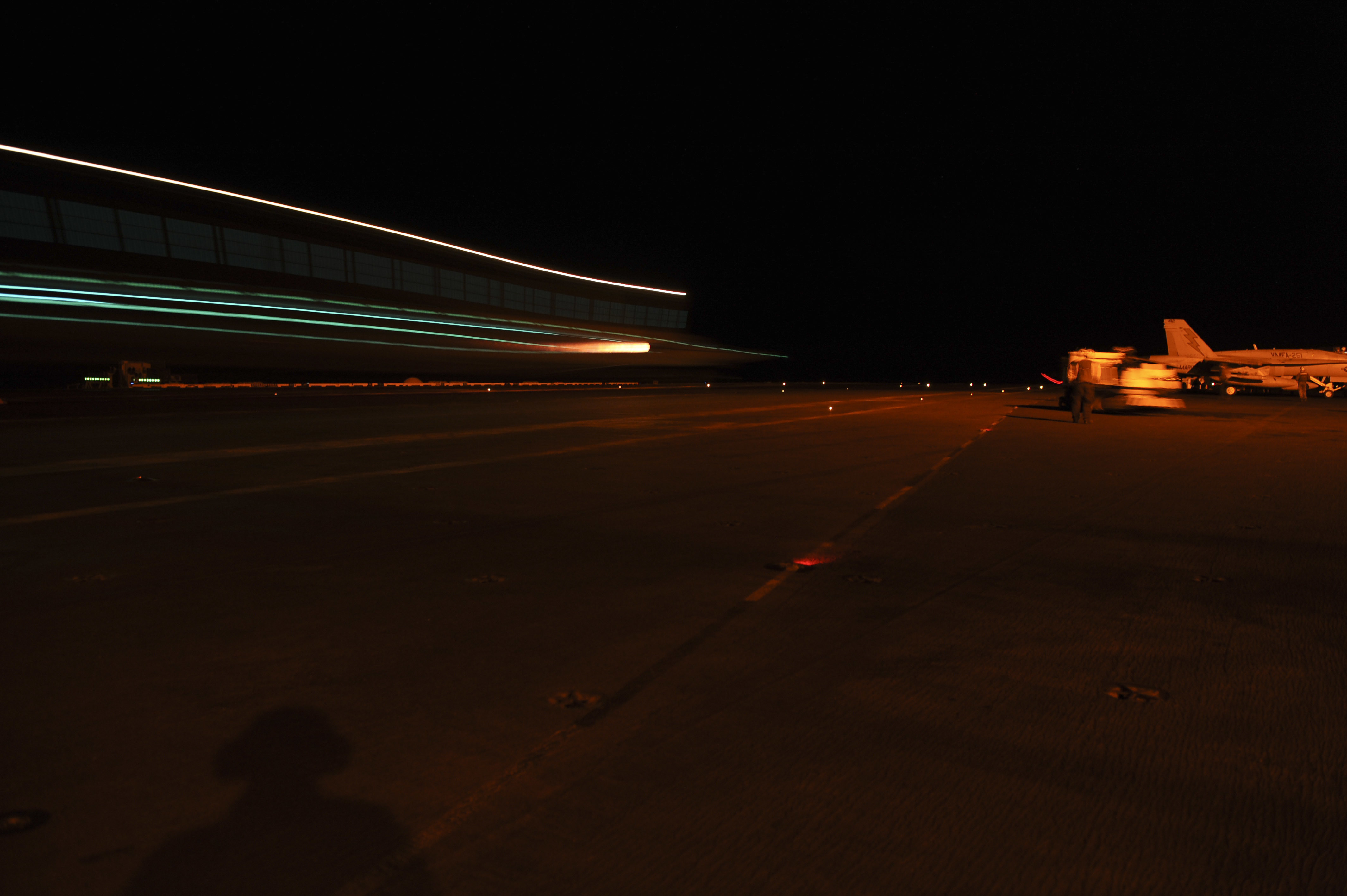 151002-N-ZF498-345 ARABIAN GULF (Oct. 2, 2015) – An F/A-18C Hornet assigned to the Thunderbolts of Marine Strike Fighter Squadron (VMFA) 251 lands on the flight deck aboard the aircraft carrier USS Theodore Roosevelt (CVN 71). Theodore Roosevelt is deployed in the U.S. 5th Fleet area of operations supporting Operation Inherent Resolve, strike operations in Iraq and Syria as directed, maritime security operations and theater security cooperation efforts in the region. (U.S. Navy photo by Mass Communication Specialist 3rd Class Anthony N. Hilkowski/Released)