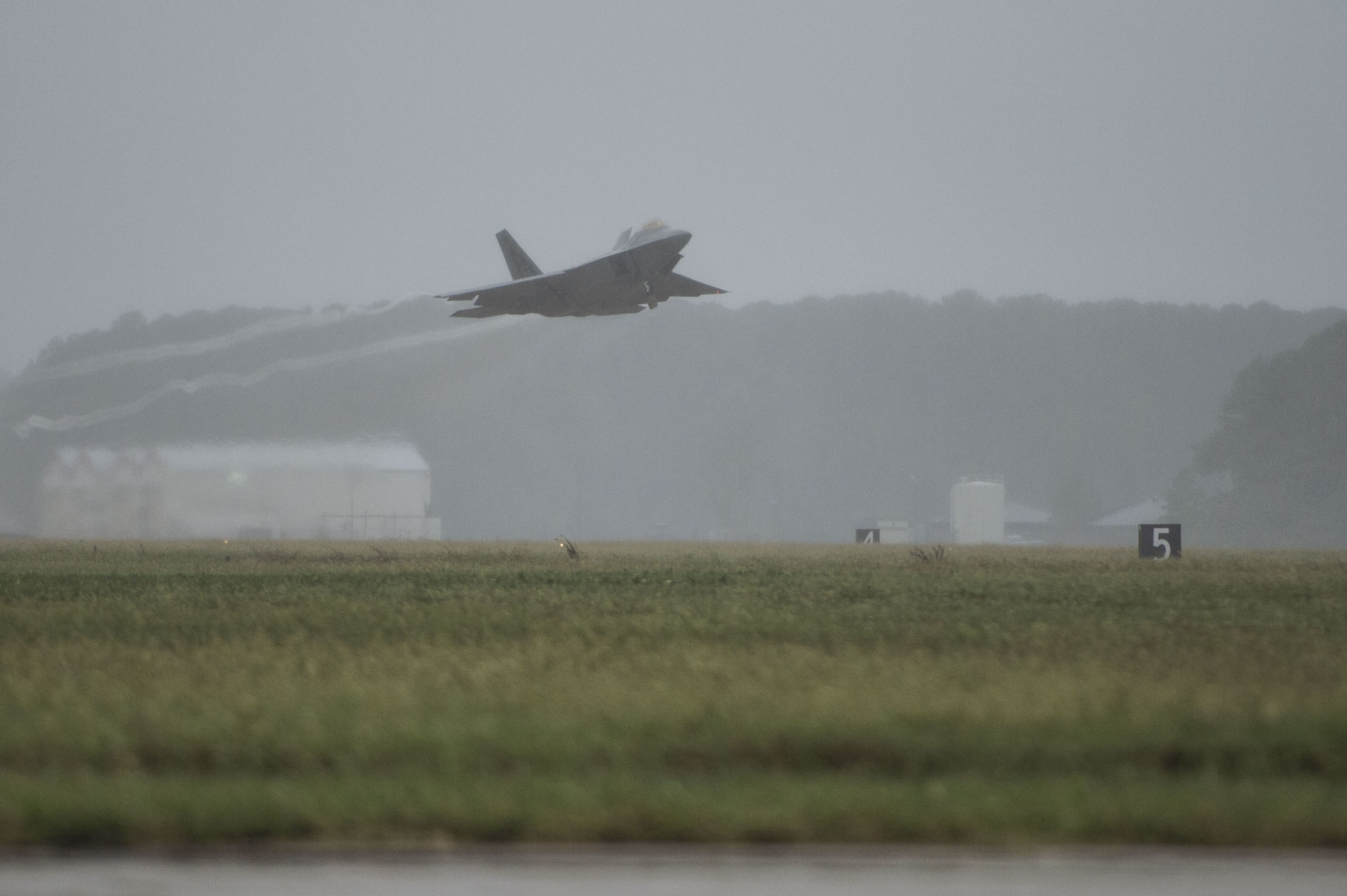 An F-22 Raptor takes off from the runway at Langley Air Force Base, Va., Oct. 1, 2015. As a result of Hurricane Joaquin, Joint Base Langley-Eustis is expected to receive heavy precipitation, high winds, storm surges and flooding. (U.S. Air Force photo by Senior Airman Kayla Newman/Released)