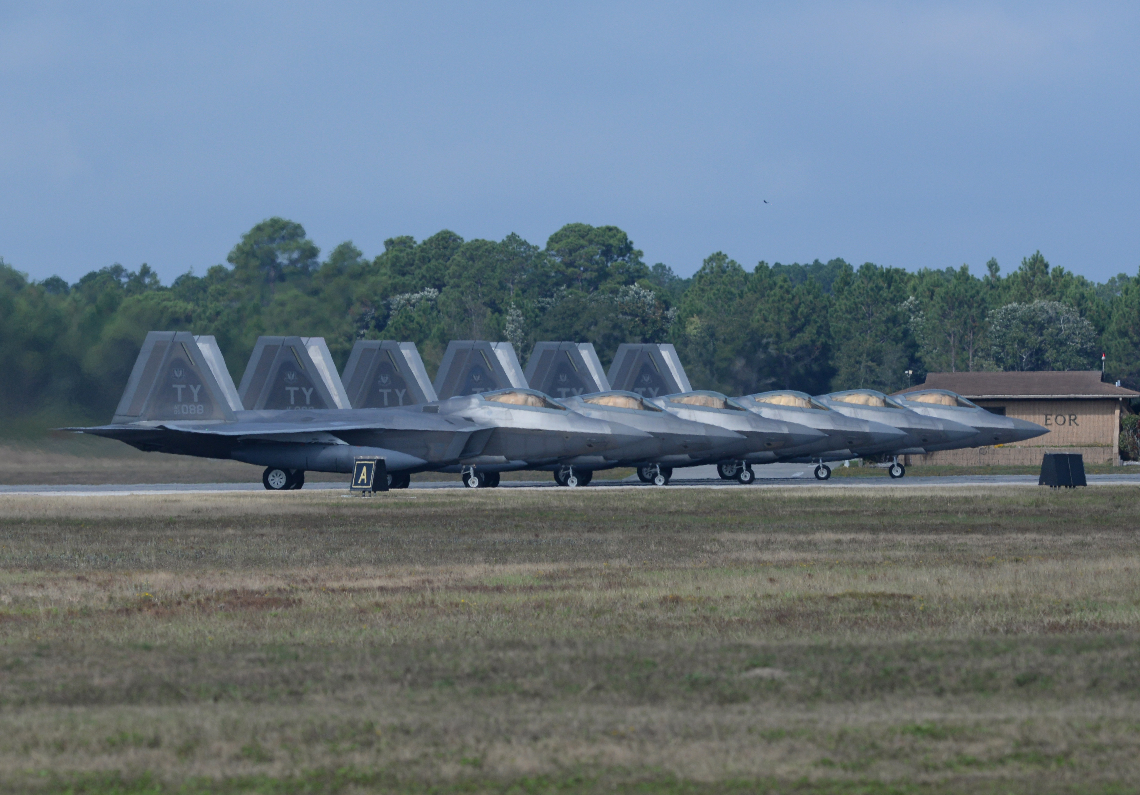 Six 95th Fighter Squadron F-22 Raptors line up before takeoff Nov. 5 at the Tyndall Air Force Base, Fla., flightline. Tyndall AFB is the world's largest contingent of F-22s. (U.S. Air Force Photo by Senior Airman Sergio Gamboa/Released)