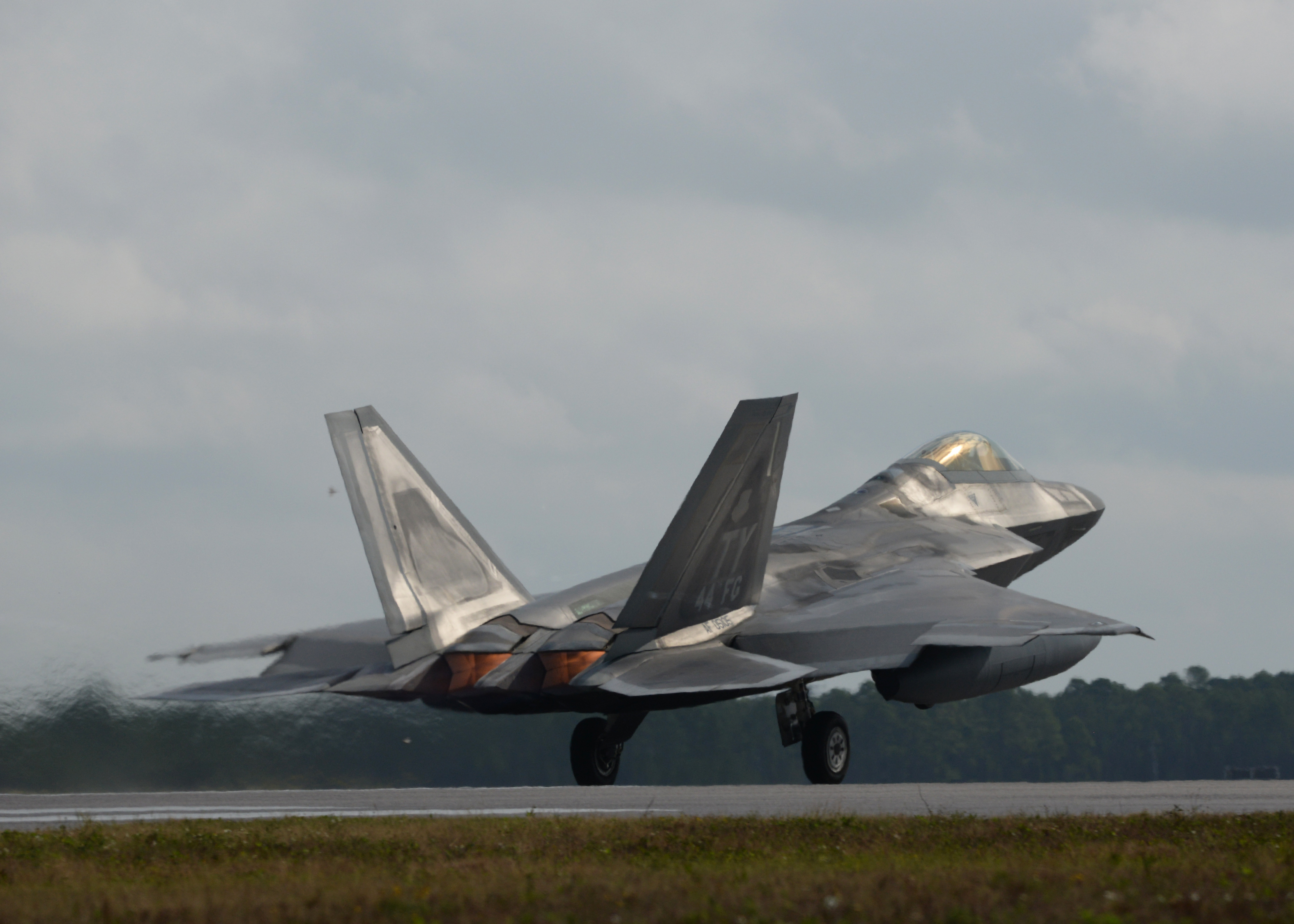 An F-22 Raptor from Tyndall Air Force Base, Fla., takes off in full after burner Nov. 5 at the Tyndall flightline. The F-22 Raptor's combination of stealth, supercruise, maneuverability and integrated avionics, coupled with improved supportability, represents an exponential leap in warfighting capabilities and allows for the full realization of operational concepts that are vital to the 21st century Air Force. (U.S. Air Force photo by Senior Airman Sergio A. Gamboa/Released)