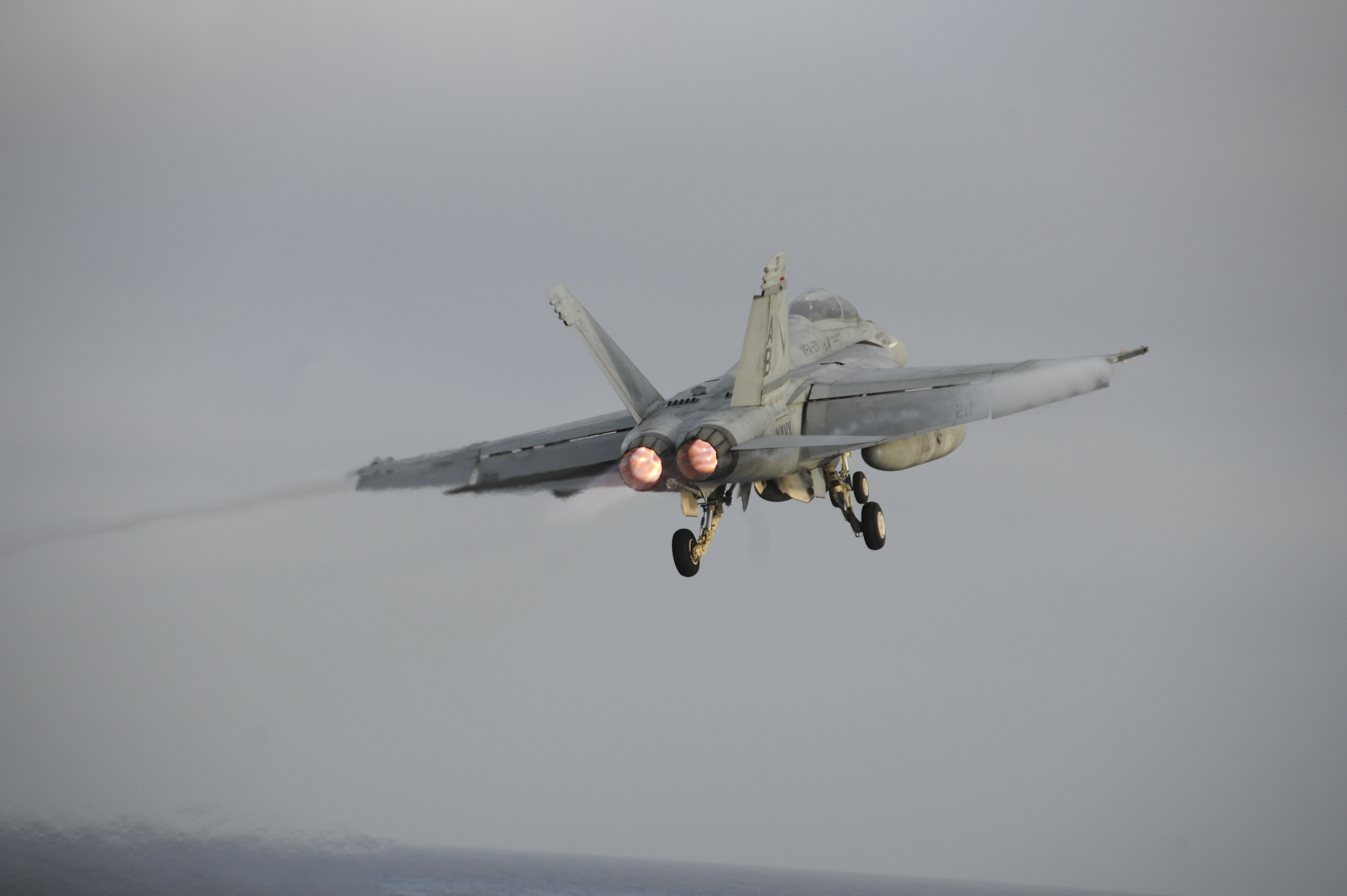 151121-N-NV908-508 PACIFIC OCEAN (Nov. 21, 2015) – An F/A-18F Super Hornet, assigned to the Checkmates of Strike Fighter Squadron (VFA) 211, launches off the flight deck of the aircraft carrier USS Theodore Roosevelt (CVN 71). The Checkmates,  along with all Carrier Air Wing One aircraft, are on their way home after completing an eight-month deployment as part of the Theodore Roosevelt Carrier Strike Group.  Theodore Roosevelt is operating in the U.S. 3rd Fleet area of operations as part of a worldwide deployment en route to its new homeport in San Diego to complete a three-carrier homeport shift. (U.S. Navy Photo by Mass Communication Specialist Seaman Chad M. Trudeau/Released)
