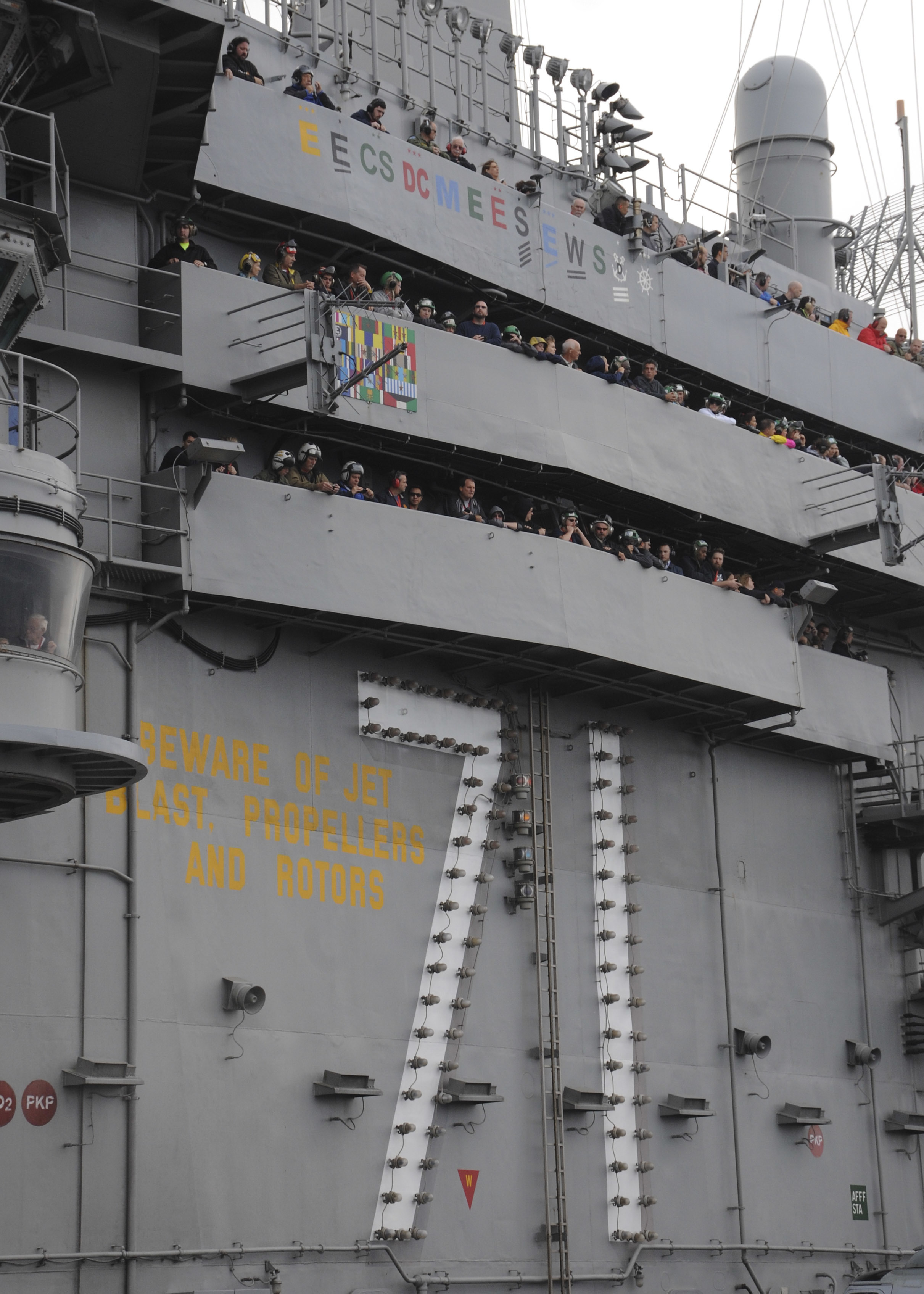 151121-N-NV908-665 PACIFIC OCEAN (Nov. 21, 2015) – Sailors, Marines and guests observe the final jet launches of deployment from the island of the aircraft carrier USS Theodore Roosevelt (CVN 71. Tiger cruises allow crew members to bring family and friends aboard to experience shipboard life. Theodore Roosevelt is operating in the U.S. 3rd Fleet area of operations as part of a worldwide deployment en route to its new homeport in San Diego to complete a three-carrier homeport shift. (U.S. Navy Photo by Mass Communication Specialist Seaman Chad M. Trudeau/Released)