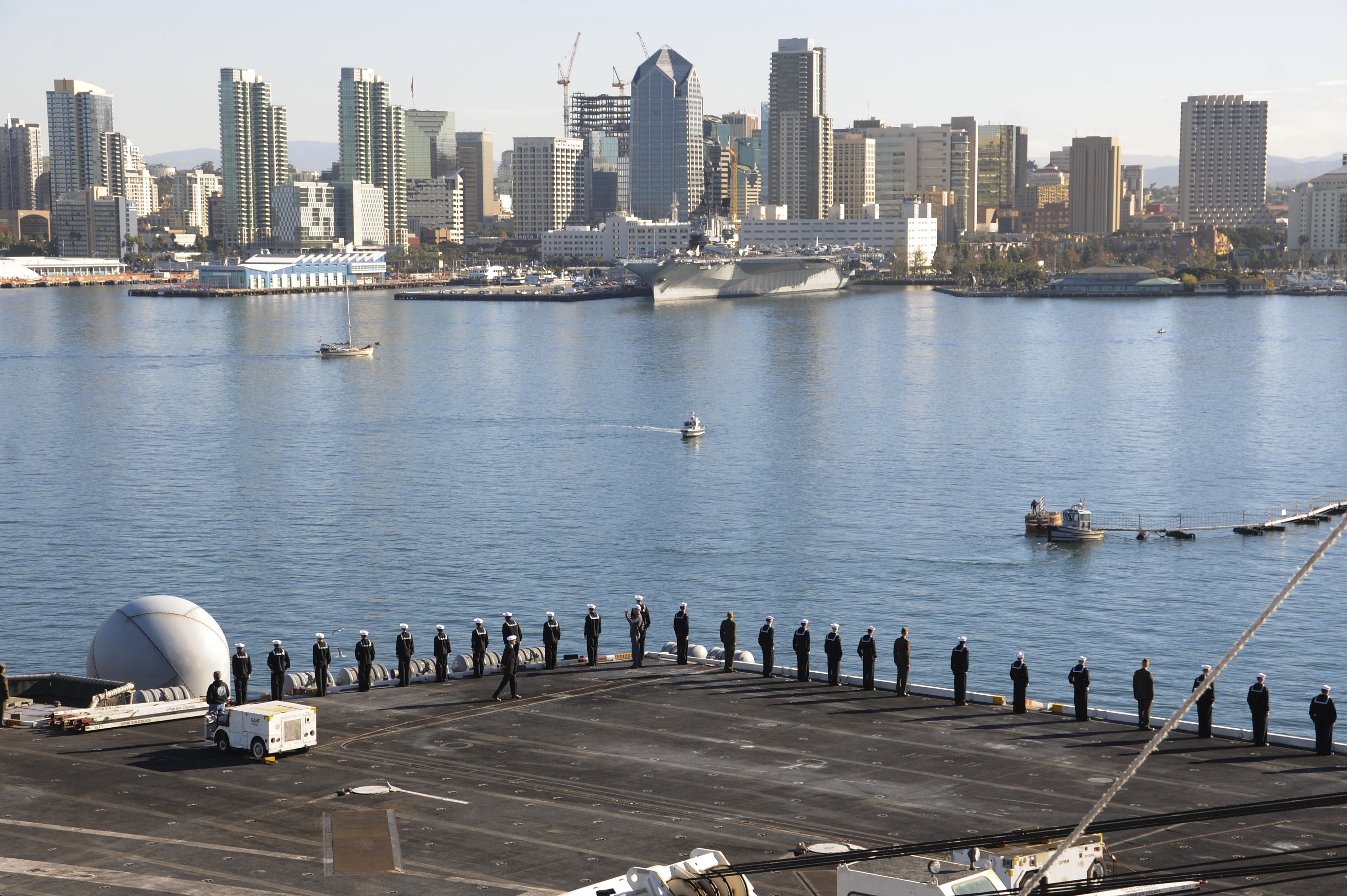 151123-N-NV908-151 SAN DIEGO (Nov. 23, 2015) Sailors and Marines man the rails while the aircraft carrier USS Theodore Roosevelt (CVN 71) moors to the pier at her new homeport. Theodore Roosevelt arrived at its new homeport in San Diego after completing an eight month around the world deployment. (U.S. Navy Photo by Mass Communication Specialist Seaman Chad M. Trudeau/Released)