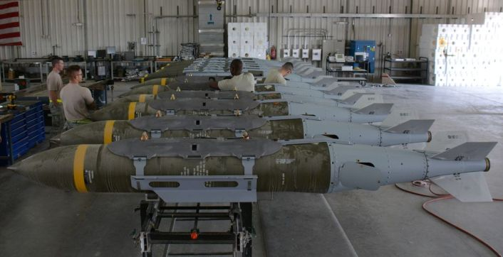 A dozen 2,000-pound joint direct attack munitions sit inside a warehouse at Al Udeid Air Base, Qatar, Dec. 17. The bombs were built by hand by airmen from the 379th Expeditionary Maintenance Squadron's Munitions Flight. The Munitions Flight has built nearly 4,000 bombs since July 2015. (U.S. Air Force photo by Tech. Sgt. James Hodgman/Released)