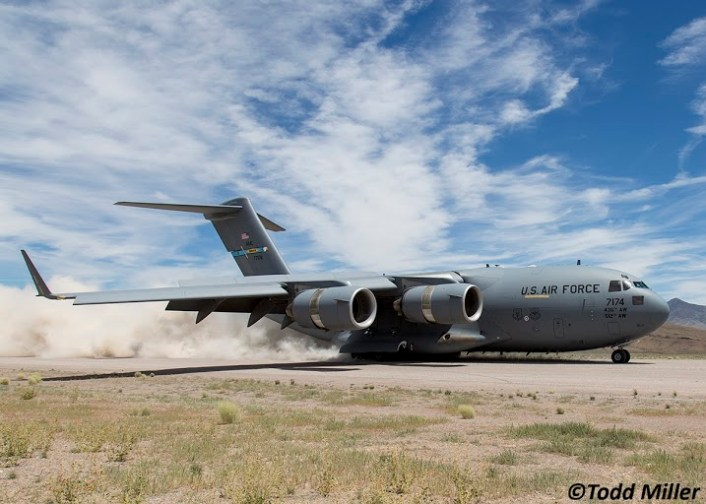 Air Mobility Command C-17A of the 436th AW/512 AW, Dover, DE kicks up the dust as it lands at Keno Airfield on the NTTR during Joint Forcible Entry Exercise (June 2016).