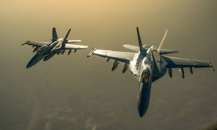 Two U.S. Navy F/A-18 Super Hornet fly in formation after receiving fuel from a KC-135 Stratotanker over Iraq in support of Operation Inherent Resolve Oct 17, 2016. The KC-135 provides the core aerial refueling capability for the U.S. Air Force and has excelled in this role for more than 50 years. (U.S. Air Force photo by Staff Sgt. Douglas Ellis/Released)