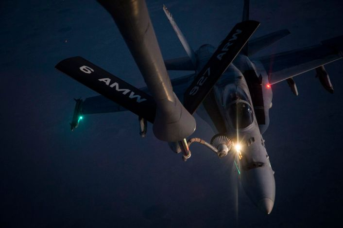 A U.S. Navy F/A-18 Super Hornet receives fuel from a KC-135 Stratotanker over Iraq Sept. 28, 2016. Airmen from the 340th Expeditionary Air Refueling Squadron refueled U.S. Navy F/A-18 Super Hornets over Iraq in support of Combined Joint Task Force-Operation Inherent Resolve. The U.S. and more than 60 coalition partners work together to eliminate Daesh and the threat they pose to Iraq and Syria. (U.S. Air Force photo/Tech. Sgt. Larry E. Reid Jr., Released)