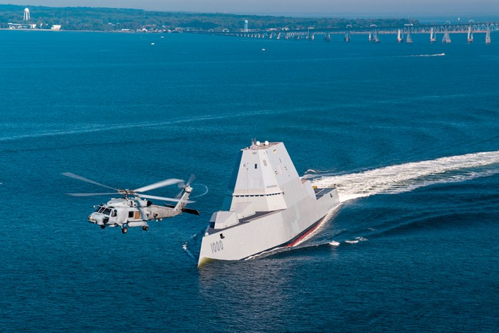 161017-N-CE233-334 CHESAPEAKE BAY, Md. (Oct. 17, 2016) An SH-60R assigned to Air Test and Evaluation Squadron (HX) 21 flies near USS Zumwalt (DDG 1000) as the ship travels to its new home port of San Diego, California. Zumwalt was commissioned in Baltimore, Maryland, Oct. 15 and is the first in a three-ship class of the Navy's newest, most technologically advanced multi-mission guided-missile destroyers. (U.S. Navy photo by Liz Wolter/Released)