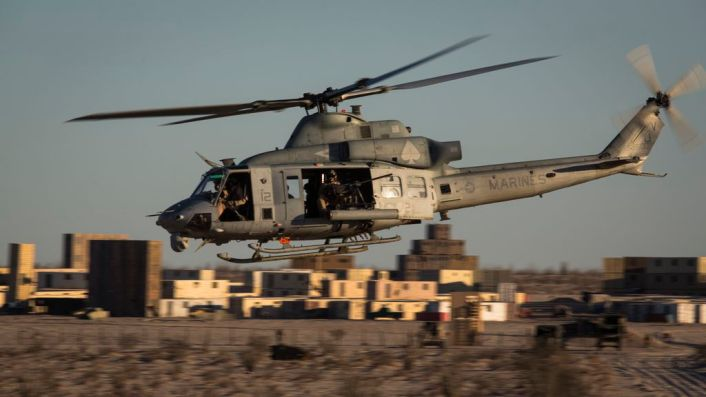 A U.S. Marine Corps UH-1Y Venom assigned to Marine Aviation Weapons and Tactics Squadron One (MAWTS-1) prepares to engage targets during an urban close air support exercise at Yodaville, Yuma, Ariz., Sept. 30, 2016. The urban close air support exercise was part of Weapons and Tactics Instructor Course (WTI) 1-17, a seven-week training event, hosted by MAWTS-1 cadre, which emphasizes operational integration of the six functions of Marine Corps aviation in support of a Marine Air Ground Task Force. MAWTS-1 provides standardized advanced tactical training and certification of unit instructor qualifications to support Marine Aviation Training and Readiness and assists in developing and employing aviation weapons and tactics. (U.S. Marine Corps photo by Lance Cpl. Danny Gonzalez 1st MARDIV COMCAM)