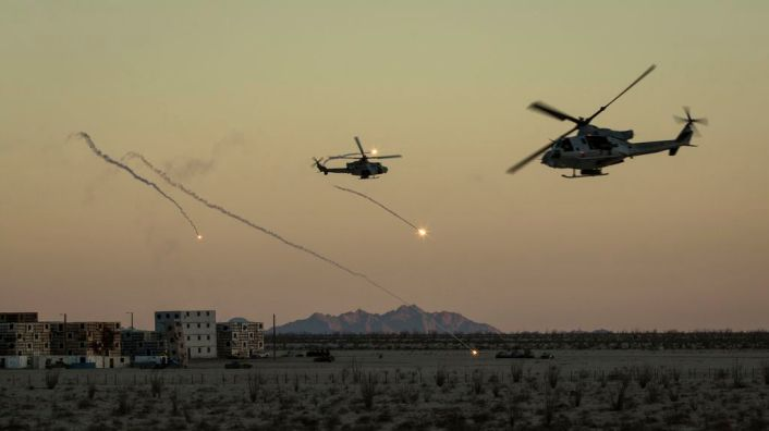 U.S. Marine Corps UH-1Y Venoms assigned to Marine Aviation Weapons and Tactics Squadron One (MAWTS-1) engages targets during an urban close air support exercise at Yodaville, Yuma, Ariz., Sept. 30, 2016. The urban close air support exercise was part of Weapons and Tactics Instructor Course (WTI) 1-17, a seven-week training event, hosted by MAWTS-1 cadre, which emphasizes operational integration of the six functions of Marine Corps aviation in support of a Marine Air Ground Task Force. MAWTS-1 provides standardized advanced tactical training and certification of unit instructor qualifications to support Marine Aviation Training and Readiness and assists in developing and employing aviation weapons and tactics. (U.S. Marine Corps photo by Lance Cpl. Danny Gonzalez 1st MARDIV COMCAM)