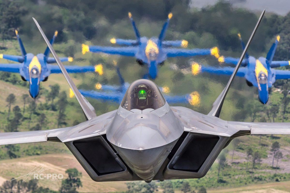 These Photos Of The F-22 Raptor Flying With The Blue Angels