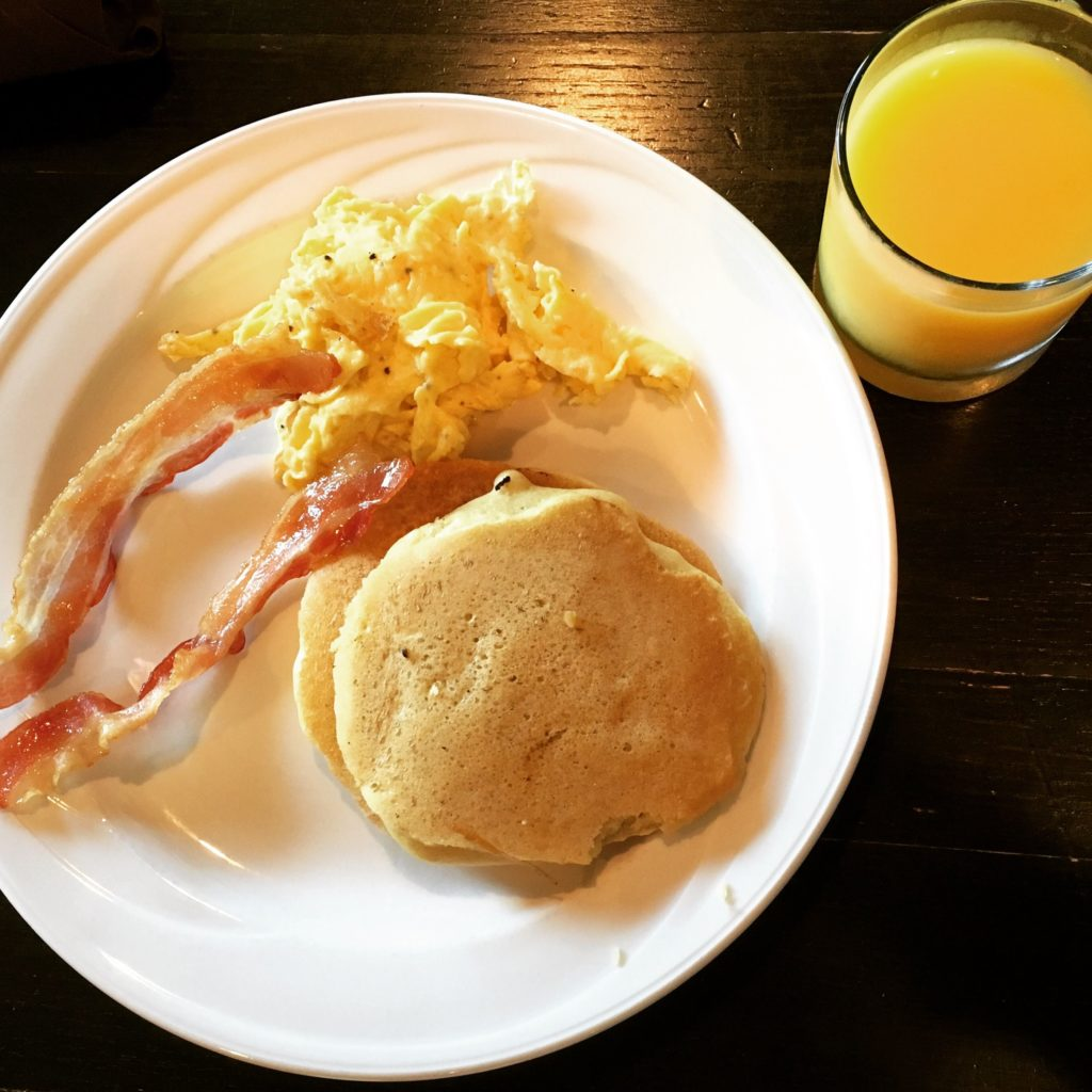 Fresh Orange Juice with Pancakes, Scrambled Eggs and Bacon