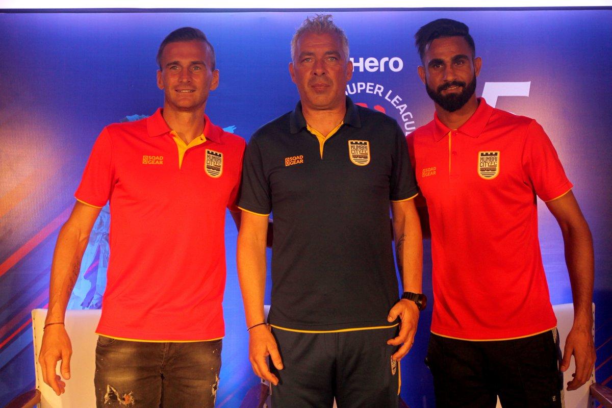 Mumbai coach Jorge Costa with club captain Lucian Goian and Amrinder Singh. Photo Courtesy: @MumbaiCityFC/Twitter