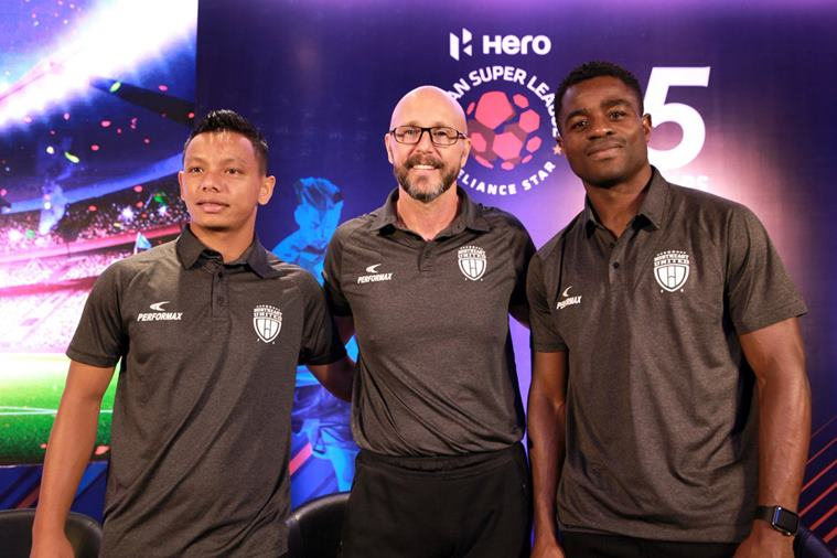 Coach Eelco Schattorie, Bartholomew Ogbeche and Redeem Tlang on ISL media day.