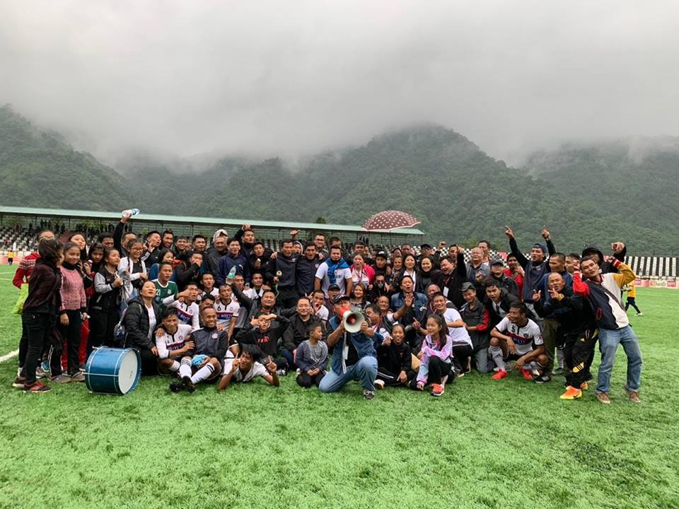 Chhinga Veng FC players pose for photographs with their traveling fans at Serchhip Ground. Photo Courtesy: @ChhingaVengFC/Facebook