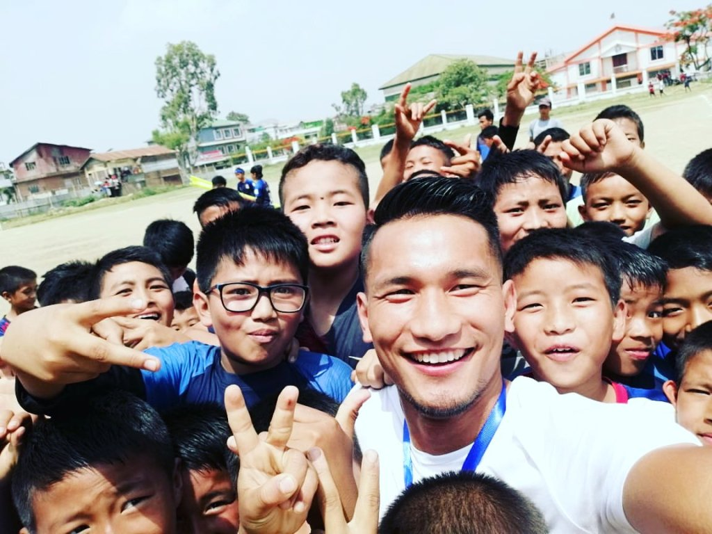 Seiminlen Doungel with young football fans in Churachandpur