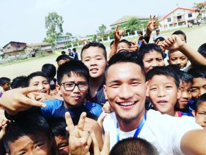 Seiminlen Doungel with young football fans in Churachandpur